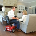 amigo_mobility_rtx_personal_electric_scooter_in_home_senior_care_facility_fireplace